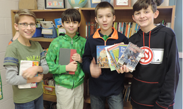 Group of boys holding books