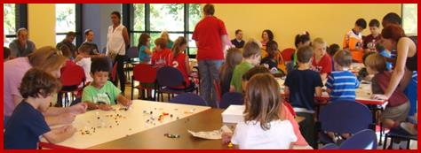 Children playing with legos at lego event