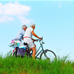 Elderly couple riding bicycles.